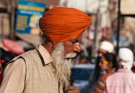 sikhism: AMRITSAR, INDIA, DEC - 7, 2014: Unidentified Indian Sikh man on the street in Amritsar, Punjab.  It is home to the Harmandir Sahib (Golden Temple), the spiritual and cultural center for the Sikh religion.