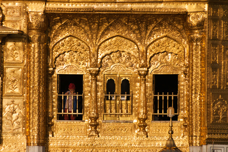 harmandir sahib: AMRITSAR, INDIA, DEC - 7, 2014: Windows of Golden Temple (Harmandir Sahib also Darbar Sahib). Golden Temple is the holiest Sikh gurdwara located in the city of Amritsar, Punjab, India. Editorial
