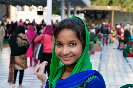 darbar sahib: AMRITSAR, INDIA, DEC - 7, 2014: Unidentified girlein Golden Temple (Harmandir Sahib also Darbar Sahib). Golden Temple is the holiest Sikh gurdwara located in the city of Amritsar, Punjab, India. Editorial