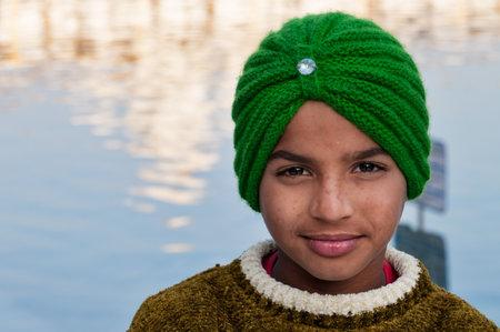 darbar sahib: AMRITSAR, INDIA, DEC - 7, 2014: Unidentified Indian Sikh boy in Golden Temple (Harmandir Sahib also Darbar Sahib). Golden Temple is the holiest Sikh gurdwara located in the city of Amritsar, Punjab, India. Editorial