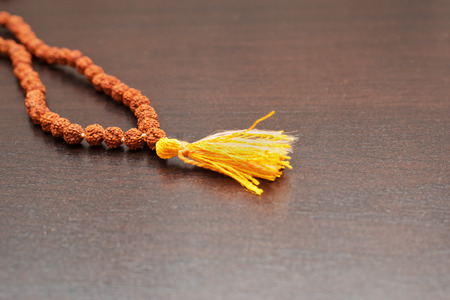 hindus: Japa mala on the table. Prayer beads made from the seeds of the rudraksha tree Stock Photo