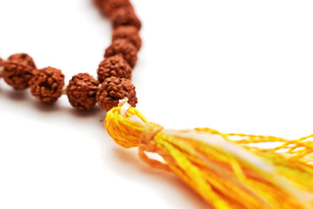 Japa mala. Prayer beads made from the seeds of the rudraksha tree. Isolated on white background Imagens