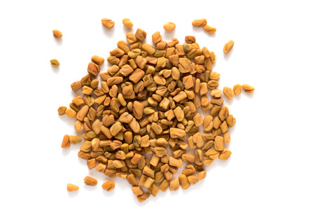 Pile of Fenugreek seeds isolated on white background Imagens