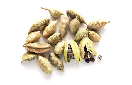 Pile of Green cardamom isolated on white background