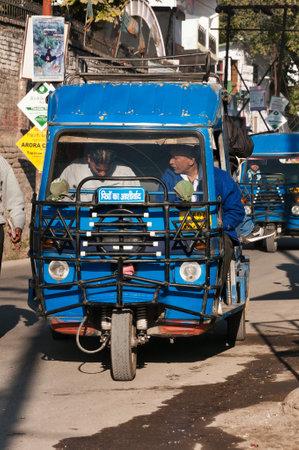 auto rickshaw: RISHIKESH, INDIA - DEC 11, 2014: Auto rickshaw or tuk-tuk on public stop on the street. Rishikesh is  World Capital of Yoga,  has numerous yoga centres that also attract tourists
