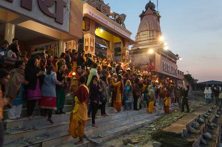 ashram: RISHIKESH, INDIA - DEC 11, 2014: Ganga Aarti ceremony in Parmarth Niketan ashram at sunset. Rishikesh is  World Capital of Yoga,  has numerous yoga centres that also attract tourists Editorial