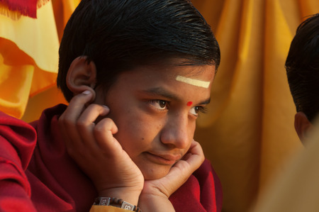 ashram: RISHIKESH, INDIA - DEC 12, 2014: Unidentified young novice on Ganga Aarti ceremony in Parmarth Niketan ashram at sunset. Rishikesh is World Capital of Yoga,  has numerous yoga centres that also attract tourists Editorial