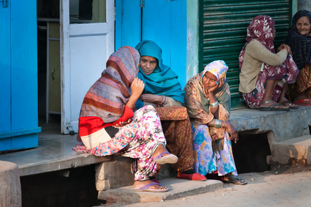 indian blue: VRINDAVAN, INDIA - DEC 15, 2014:  Unidentified Indian women sit and chat on a house porch. Vrindavan is considered to be a holy place. The major tradition followed in the area is Vaisnavism. It is the place where Krishna spent his childhood days.