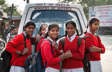 AGRA, INDIA - DEC 17, 2014: Unidentified Indian young schoolgirl on the street in Agra