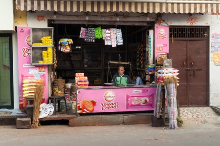 fatehpur sikri: AGRA, INDIA - DEC 17, 2014: Indian local shop in Agra. Agra is major tourist destination because of its many splendid Mughal-era buildings, most notably the Taj Mahal, Agra Fort and Fatehpur Sikri