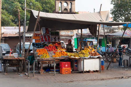 fatehpur sikri: AGRA, INDIA - DEC 17, 2014: Fruit shop on the market in Agra. Agra is major tourist destination because of its many splendid Mughal-era buildings, most notably the Taj Mahal, Agra Fort and Fatehpur Sikri