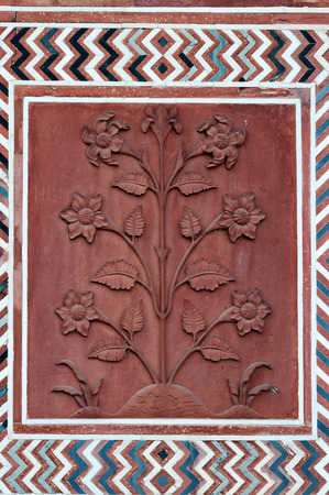 inlaid: Detail decorative of the Jawab. Patterns in red sand stone with inlaid marble. Taj Mahal. Agra. India