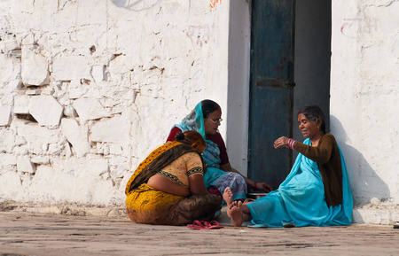 madhya pradesh: ORCHHA, INDIA - DEC 19, 2014: Unidentified Indian women sit and chat on a white house porch
