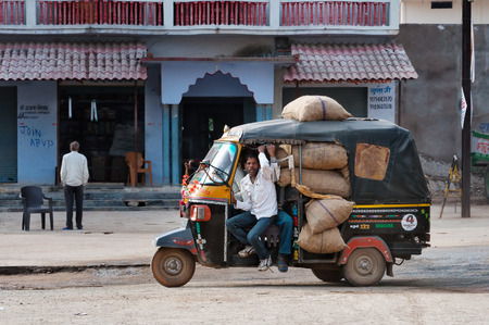 autorick: ORCHHA, INDIA - DEC 19, 2014: Indian rickshaw with driver full of bags on the road