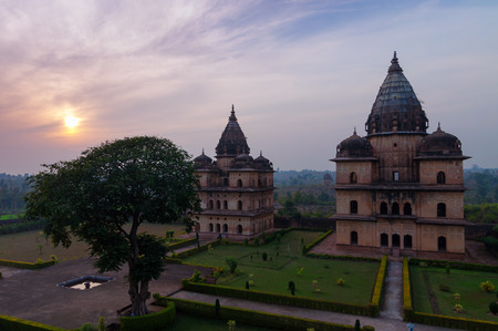 dome of hindu temple: Group of Cenotaphs along the river Betwa in Orchha at sunset.  Madhya Pradesh. India
