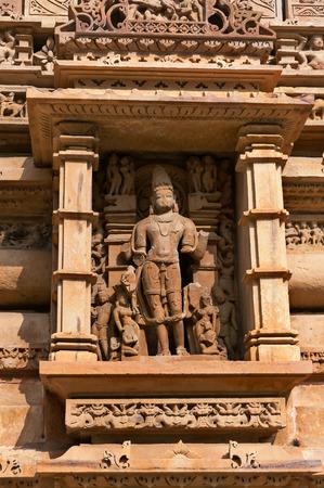 madhya: Stone carved sculpture of god Male Deity on Lakshmana temple. Western temples of Khajuraho. Madhya Pradesh. India. Built around 999 Stock Photo