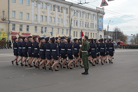 minin: NIZHNY NOVGOROD, RUSSIA - MAY 4, 2015: Women soldiers in uniform are at rehearsal of Military Parade commemorating the 70th anniversary Victory on Pozharsky and Minin Square Editorial