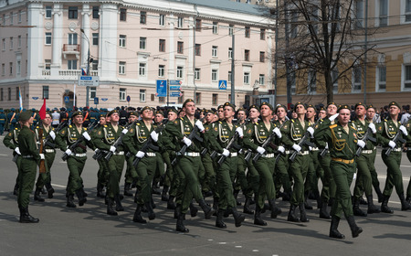 minin: NIZHNY NOVGOROD, RUSSIA - MAY 4, 2015: Soldiers in uniform are at rehearsal of Military Parade commemorating the 70th anniversary Victory on Pozharsky and Minin Square