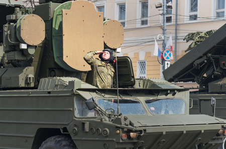 minin: NIZHNY NOVGOROD, RUSSIA - MAY 4, 2015: Soldiers in military vehicles on rehearsal of Military Parade commemorating the 70th anniversary Victory on Pozharsky and Minin Square