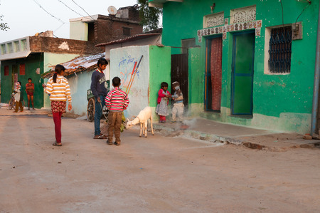 madhya pradesh: KHAJURAHO, INDIA - DEC 21, 2014: Unidentified Indian children playing on the street in the village. Khajuraho is small town with  Khajuraho Group of Monuments located in the Indian state of Madhya Pradesh