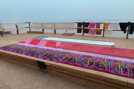 varanasi: Laundry drying near Ganga river in Harishchandra Ghat.  Varanasi. Uttar Pradesh. India Stock Photo