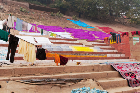 pradesh: Laundry drying on the steps of ghat near Ganga river.  Varanasi. Uttar Pradesh. India