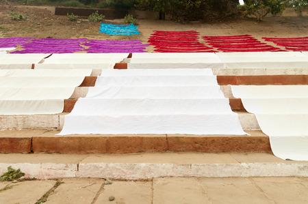 varanasi: Laundry drying on the steps of ghat near Ganga river.  Varanasi. Uttar Pradesh. India