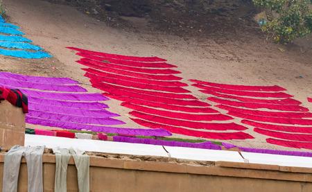 uttar: Laundry drying on the steps of ghat near Ganga river.  Varanasi. Uttar Pradesh. India