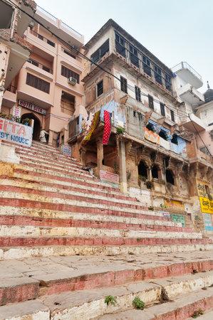 holiest: VARANASI, INDIA - DEC 23, 2014: Chousatti Ghat foggy morning. Varanasi. Uttar Pradesh. Varanasi  is the holiest of the seven sacred cities in Hinduism and Jainism.