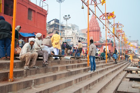 holiest: VARANASI, INDIA - DEC 23, 2014: Dashashwamedh Ghat is the main ghat in Varanasi on the Ganges River. Uttar Pradesh. Varanasi  is the holiest of the seven sacred cities in Hinduism and Jainism.