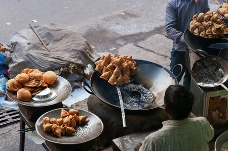 VARANASI, INDIA - DEC 23, 2014: Indian street food in the street market. Varanasi. Uttar Pradesh. India