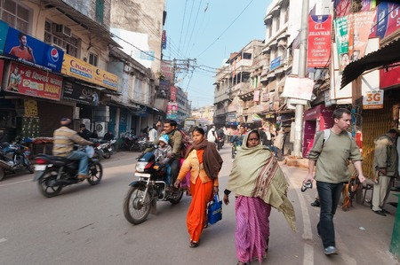 uttar: VARANASI, INDIA - DEC 23, 2014: On the street in Varanasi, Uttar Pradesh. Varanasi  is the holiest of the seven sacred cities in Hinduism and Jainism. Hindus believe that death at Varanasi brings salvation. Editorial