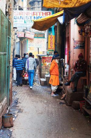 varanasi: VARANASI, INDIA - DEC 23, 2014: On the narrow street in the old city of Varanasi. Uttar Pradesh, India Editorial