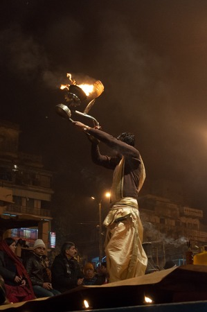 ghat: VARANASI, INDIA - DEC 23, 2014: Unidentified Indian priest performs religious Ganga Aarti ceremony or fire puja at Dashashwamedh Ghat in Varanasi. Uttar Pradesh