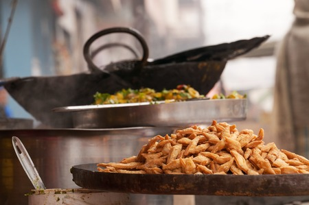 varanasi: Indian street food on the counter of market in Varanasi