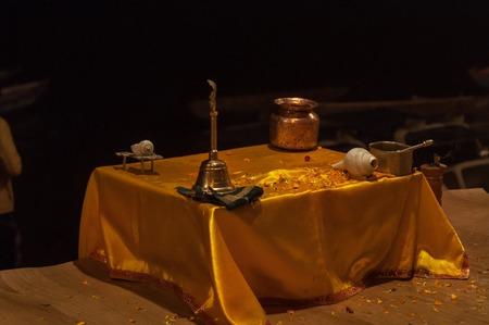 benares: Table with attributes for Ganga Aarti ceremony or fire puja at Dashashwamedh Ghat in Varanasi. Uttar Pradesh. India