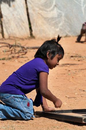 karnataka culture: BANGALORE, INDIA - DEC 26, 2014: Unidentified Indian girle playing on the street in Bangalore.  Karnataka. India