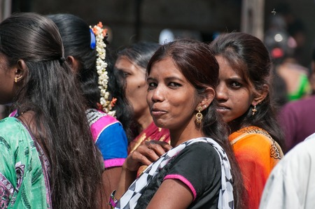 BANGALORE, INDIA - DEC 25, 2014:  Unidentified Indian women on Russell Market. Russell Market is a shopping market in Bangalore, built in 1927 by the British.