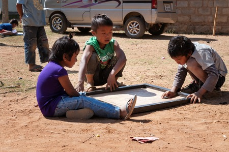 karnataka culture: BANGALORE, INDIA - DEC 26, 2014: Unidentified Indian children playing on the street in Bangalore.  Karnataka. India Editorial