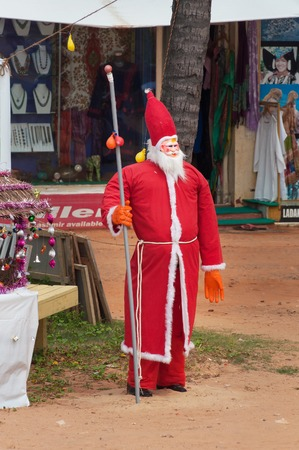 kovalam: KOVALAM, INDIA - DEC 28, 2014: Santa Claus on the Samudra beach in Kovalam. Kerala. India