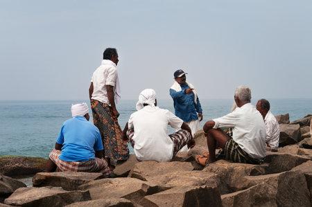 kovalam: KOVALAM, INDIA - DEC 28, 2014: Unidentified Fishermen are resting after work on Samudra beach in Kovalam. Kerala. India