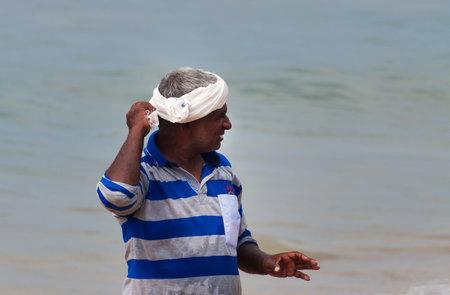 india fisherman: KOVALAM, INDIA - DEC 28, 2014: Unidentified Indian fisherman on Samudra beach in Kovalam. Kerala. India