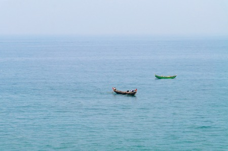 kovalam: Traditional wooden fishing boats in the ocean. Kovalam. Kerala. India