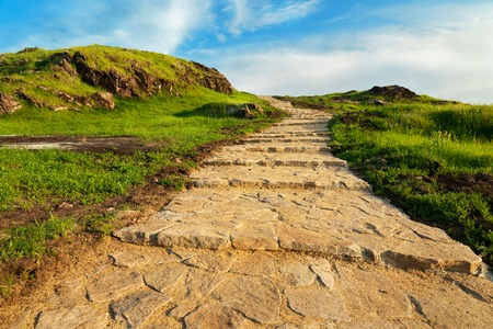heaven background: Stone stairway to heaven. Stairs up the green hill