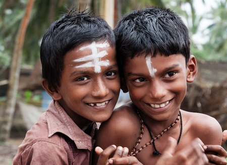 KOVALAM, INDIA - DEC 28, 2014: Unidentified two Indian boys  on the street in fishing village. Kovalam. Kerala. India