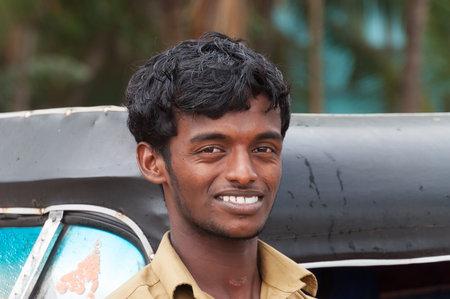 auto rickshaw: KOVALAM, INDIA - DEC 28, 2014: Unidentified Indian taxi driver man of auto rickshaw in fishing village. Kovalam. Kerala. India