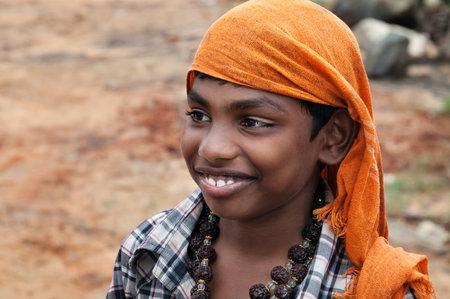 kovalam: KOVALAM, INDIA - DEC 28, 2014: Portrait of unidentified Indian boy on the street in fishing village. Kovalam. Kerala. India