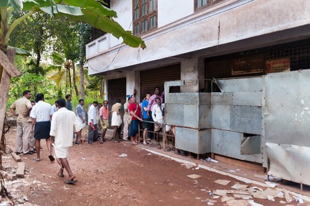 varkala: VARKALA, INDIA - DEC 30, 2014: Unidentified People stand in a queue to alcoholic shop. Varkala. Kerala. India