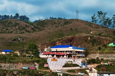munnar: Munnar, Kerala,  India - Jan 5, 2015: Hindu temple on the hill in Munnar. Munnar is a beautiful hill station, and was the summer resort of the British. Munnar is famous for its tea plantations. Editorial
