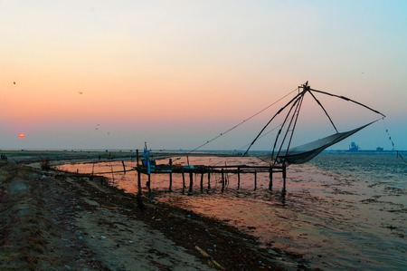 chinese fishing nets: Chinese Fishing nets at sunset. Fort Kochi. Kerala. India Stock Photo